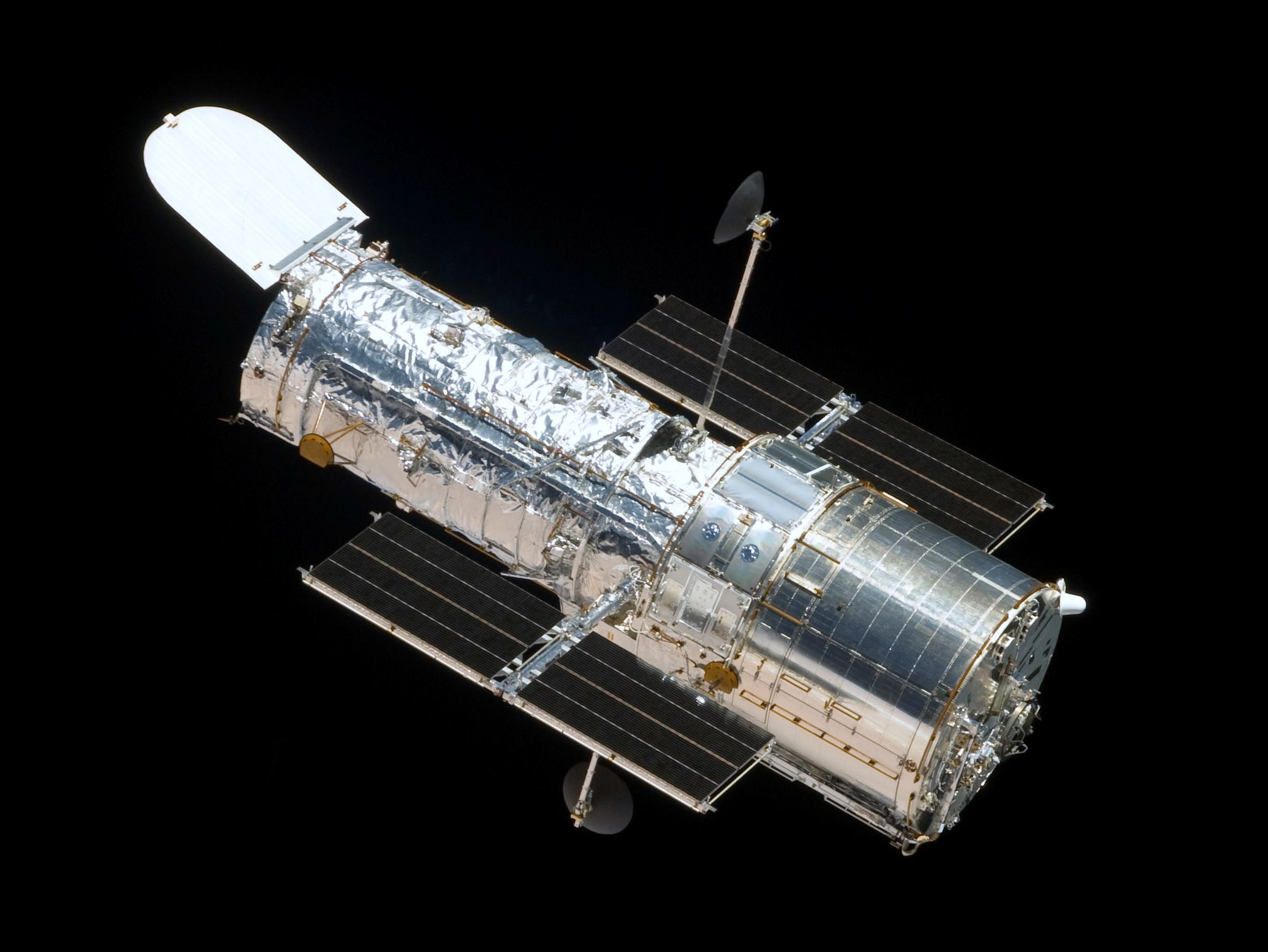 hubble space telescope In this april 25, 1990, photograph taken by the crew of the sts-31 space shuttle mission, the hubble space telescope is suspended above shuttle discovery's cargo bay some 332 nautical miles above earth.